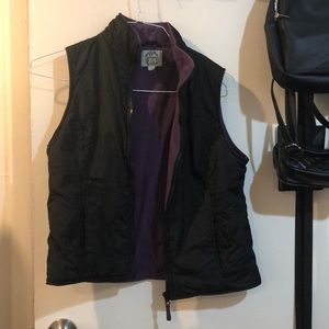 Black and purple zip up vest with pockets